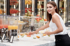Female business manager takes fruit dessert at Stock Photography