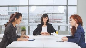 Female business partners at conclusion of important transaction, exchange documents. stock footage