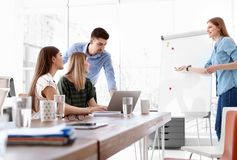 Female business trainer giving lecture. In office royalty free stock image