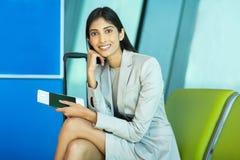 Female business traveler sitting Stock Images