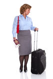 Female business traveller checking her watch Royalty Free Stock Images