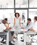 Female business woman giving a presentation Stock Photography