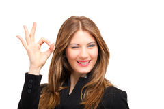 Female business woman showing ok sign. Female businesswoman showing ok sign Royalty Free Stock Photos