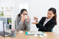 Female business woman sneezing during conference royalty free stock image