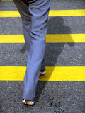 Female businesswoman crossing road Stock Photos