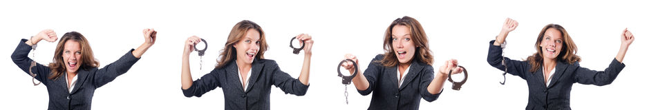 The female businesswoman with handcuffs on white Stock Image