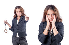 The female businesswoman with handcuffs on white Stock Photos