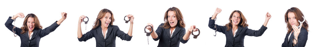The female businesswoman with handcuffs on white Stock Images