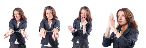 The female businesswoman with handcuffs on white Stock Photo