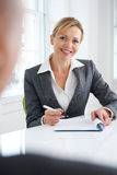 Female Businesswoman Interviewing Male Candidate Stock Images