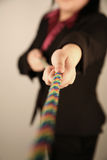 Female businesswoman pulling rope Royalty Free Stock Photo