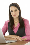 Female Businesswoman Using Laptop At Desk Royalty Free Stock Image