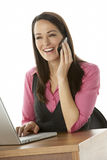 Female Businesswoman Using Laptop At Desk Stock Photography