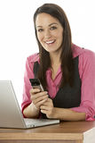 Female Businesswoman Using Laptop At Desk Stock Images