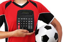 Female bust in Football Uniform holding a calculator. Photography of a female bust in Football Uniform holding a calculator Royalty Free Stock Photo