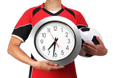 Female bust in Football Uniform holding a clock. Photography of a female bust in Football Uniform holding a clock Royalty Free Stock Images