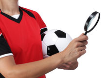 Female bust in Football Uniform holding a magnifying glass Royalty Free Stock Photography