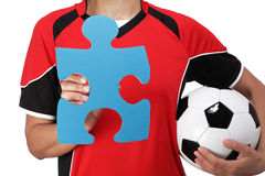Female bust in Football Uniform holding a puzzle piece. Photography of a female bust in Football Uniform holding a puzzle piece Stock Photography