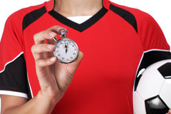 Female bust in Football Uniform holding and showing a stopwatch Royalty Free Stock Images