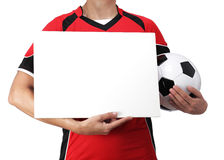 Female bust in Football Uniform holding a white sign. Photography of a female bust in Football Uniform holding a white sign Royalty Free Stock Image