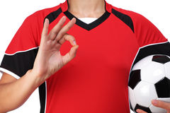 Female bust in Football Uniform making the sign all is well. Photography of a female bust in Football Uniform making the sign all is well Royalty Free Stock Photo