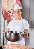 Female Butcher Holding Big Bowl In Shop Royalty Free Stock Photo