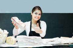 Female butcher with salty lard Stock Photos