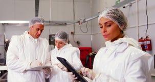 Female butcher using digital tablet stock footage
