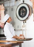 Female Butcher Weighing Meat In Butchery Royalty Free Stock Images