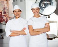 Female Butchers Smiling In Butchery Stock Photography