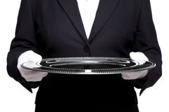 Female butler holding a silver tray isolated Stock Image