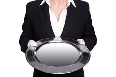 Female butler holding a silver tray isolated. Stock Photo