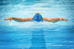 Female butterfly swimmer front view Royalty Free Stock Images