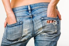 Female buttocks. Image of female hands touching beautiful buttocks in jeans Royalty Free Stock Photography