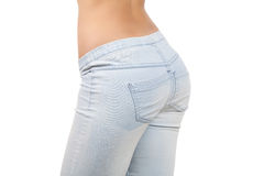 Female buttocks. Close-up of female buttocks in jeans isolated on white background Stock Photo