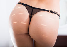 Female buttocks close up Royalty Free Stock Image