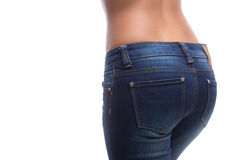 Female buttocks in jeans. Rear view of female buttocks in jeans isolated on white Stock Photo