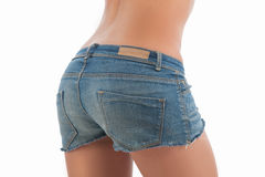 Female buttocks in shorts. Rear view of female buttocks in jeans shorts isolated on white Stock Photo