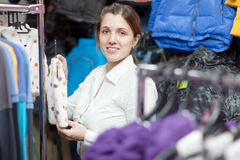 Female buyer  at children's clothing store Royalty Free Stock Image