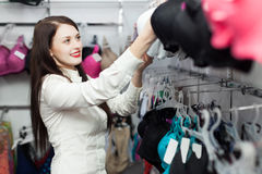 Female buyer choosing bra at clothing shop Royalty Free Stock Photo