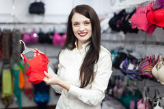 Female buyer choosing bra at clothing shop Stock Photography