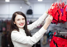 Female buyer choosing bra at clothing store Stock Images