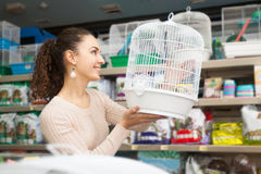 Female buying cage Royalty Free Stock Image