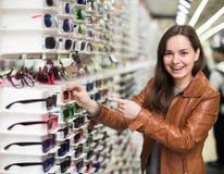 Female  buying sunglasses Stock Photos