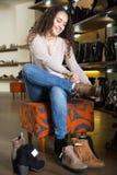 Female buying winter women shoes Stock Photos