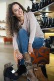 Female buying winter women shoes Royalty Free Stock Photo