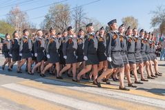 Female cadets of police academy marching on parade Stock Photos
