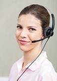 Female Call Center Employee With Headphones Stock Photo