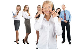 Female call center employee with her colleagues Royalty Free Stock Image