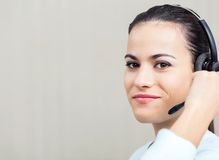 Female Call Center Employee Using Headset Royalty Free Stock Photos